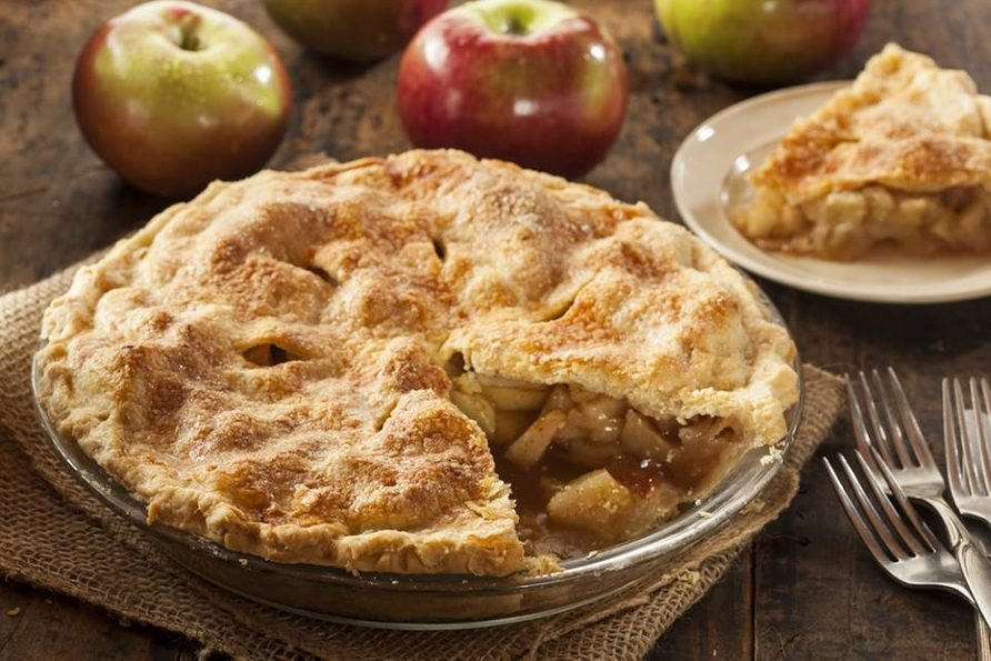 Apple cider pie on wooden table
