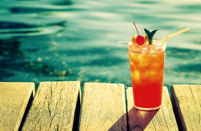 Fruit cocktail on dock of lake