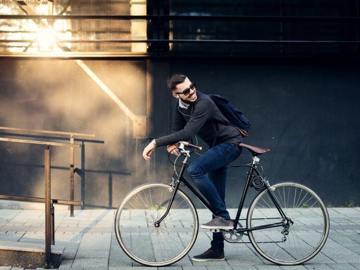 Businessman biking to work