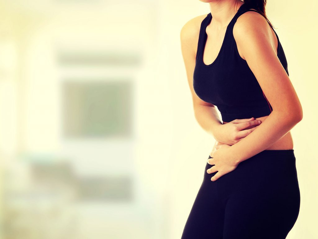 Woman experiencing digestive disorders