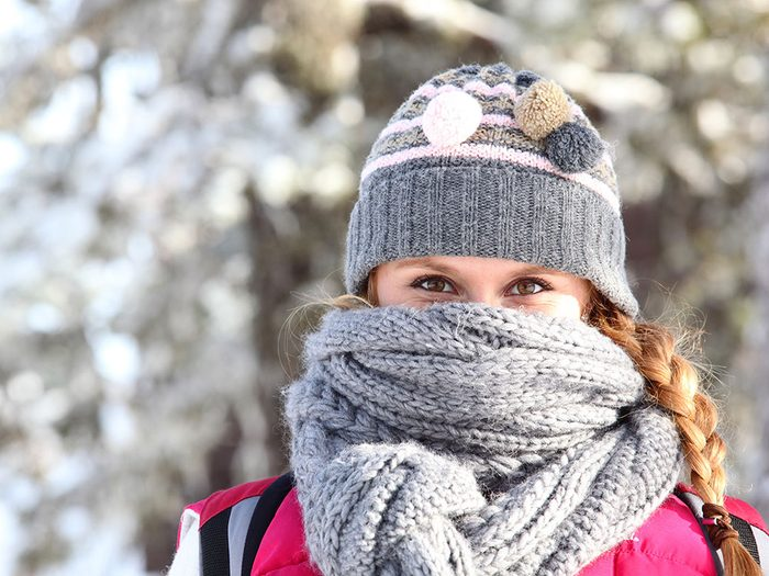Woman wearing a scarf around face