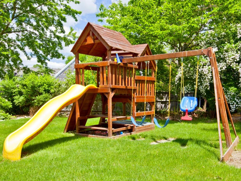 Use a garden hose to cover swing set chains