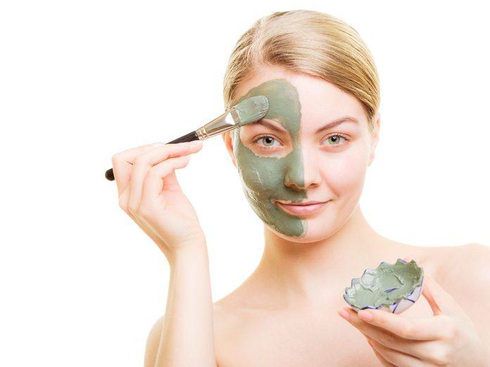 Woman applying a DIY mud mask