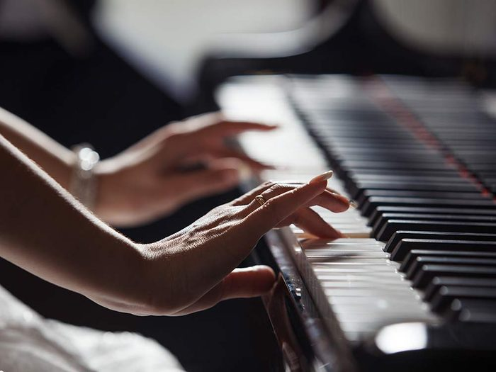 Close-up of hands on piano keys