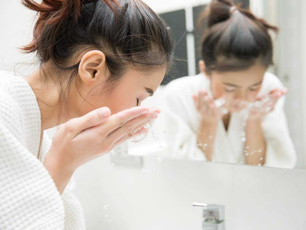 Use Mayonnaise - Woman washing face in the morning
