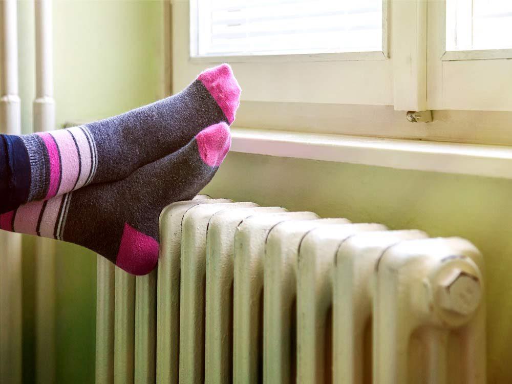 Feet on radiator