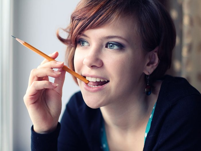 Girl chewing on pencil