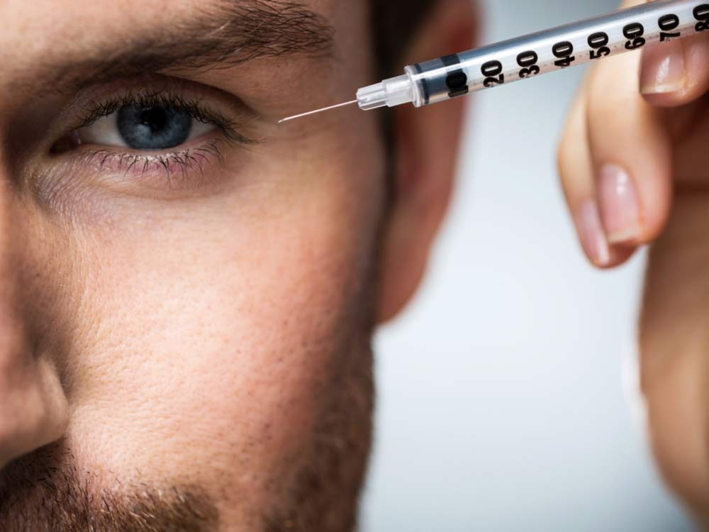 Man receiving botox treatment