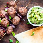 Meat kebabs with avocado tzatziki