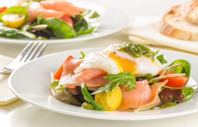 Breakfast salad with smoked salmon and poached egg
