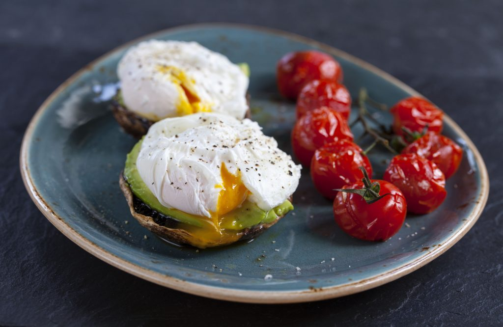 Poached eggs, portobello mushrooms and vine tomatoes