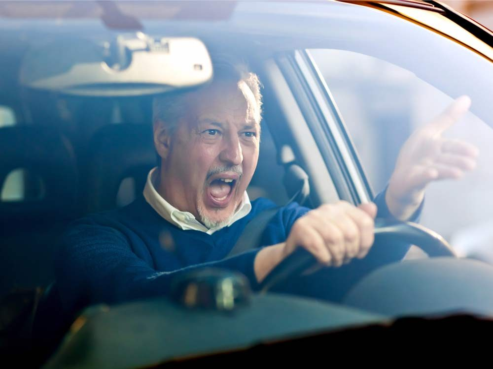 Angry old man in car