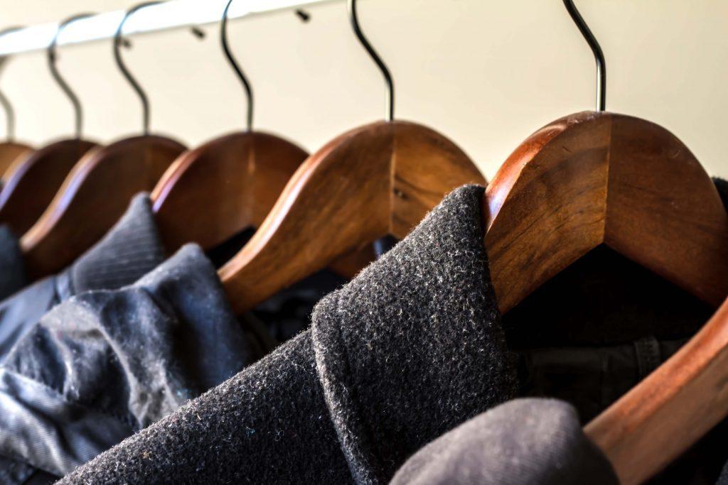 Jackets and blazers hanging on coat rack