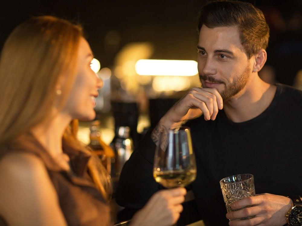 Man and woman flirting at bar