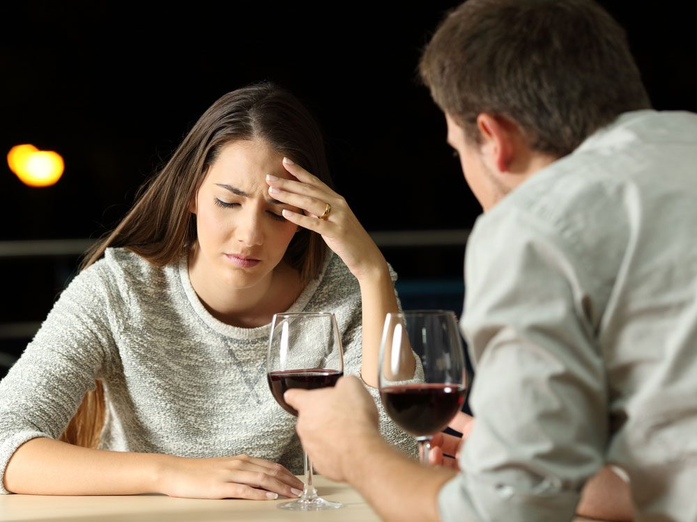 Couple fighting over wine at restaurant