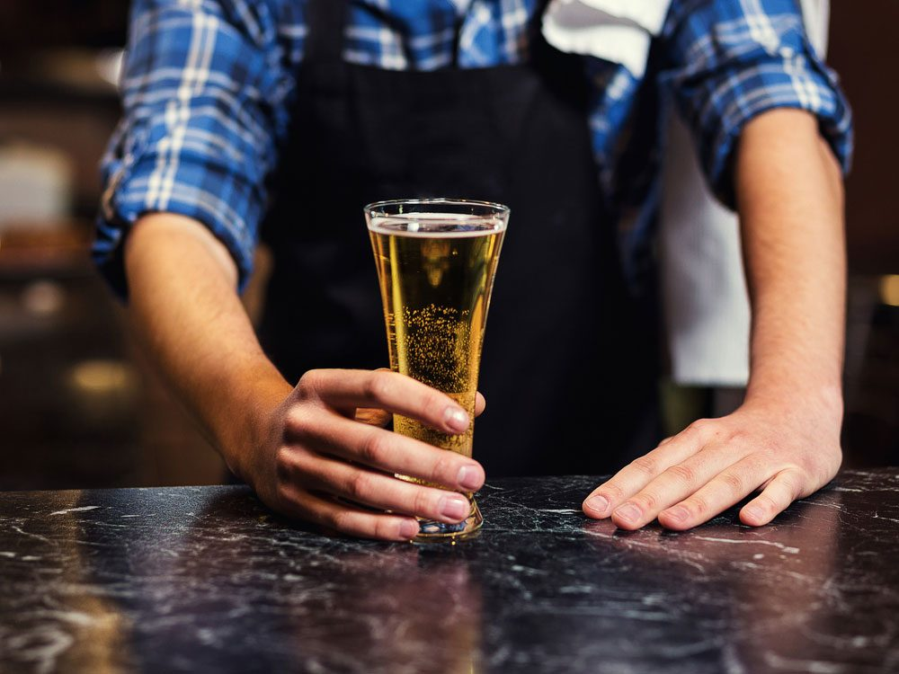 Bartender serving an ice cold beer
