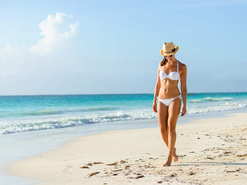 Attractive woman in bikini on beach