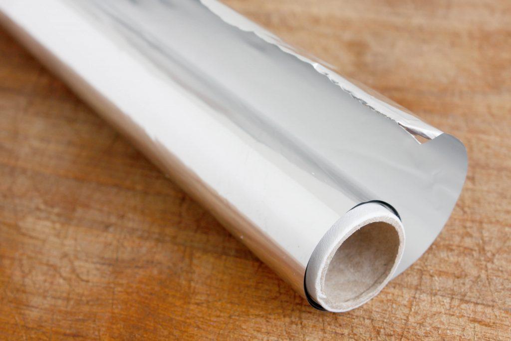 Aluminum foil on wooden table