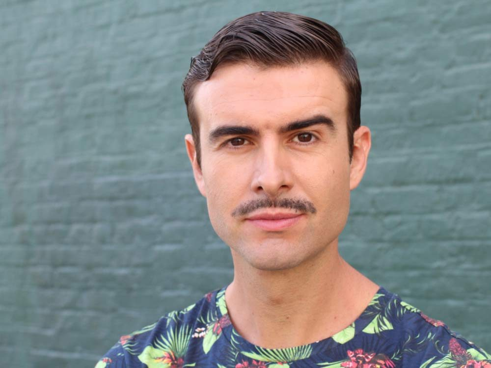 Hipster with thin moustache