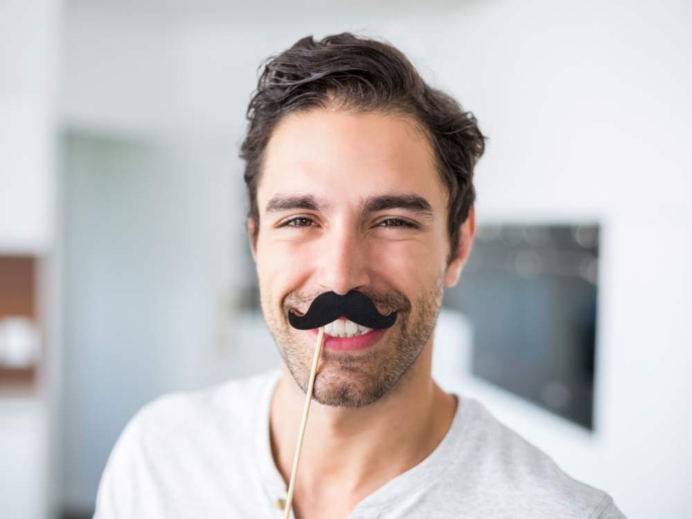 Handsome man with fake moustache