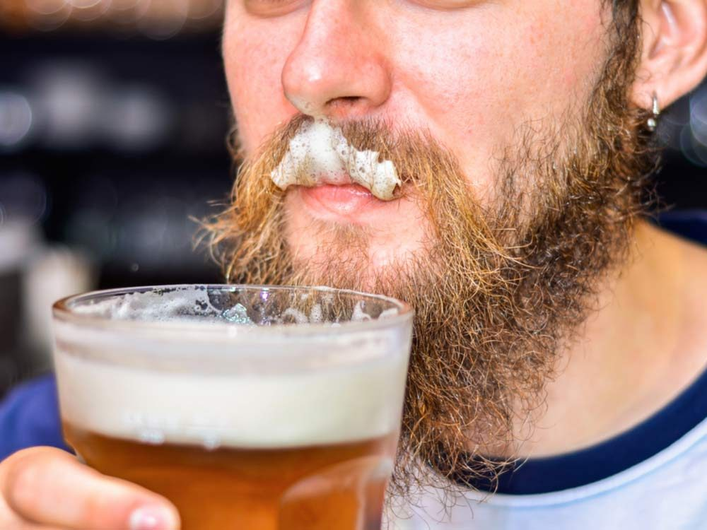 Man with beard drinking beer