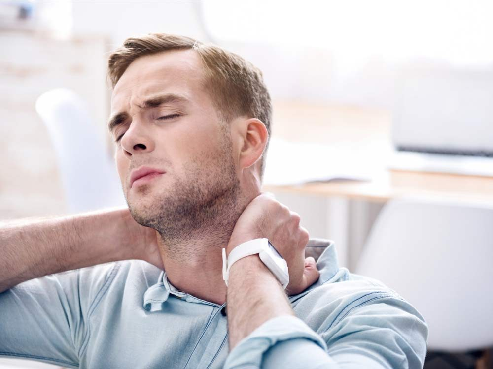 Man with neck and throat pain