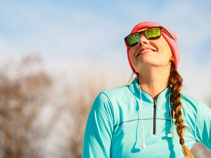 Woman wearing sunglasses during running
