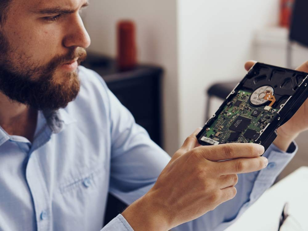 Man examining computer part