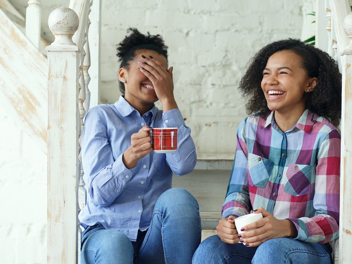 Stress management tips - Two friends laughing