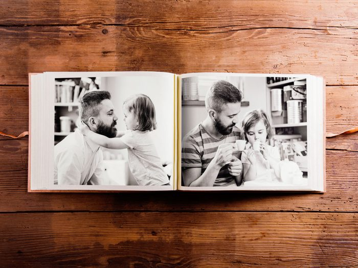 Photo album with pictures of father and daughter