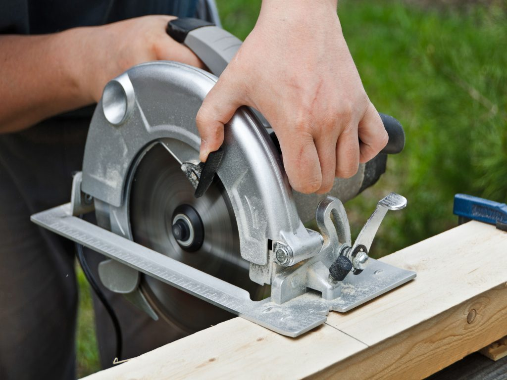 A man using a power saw