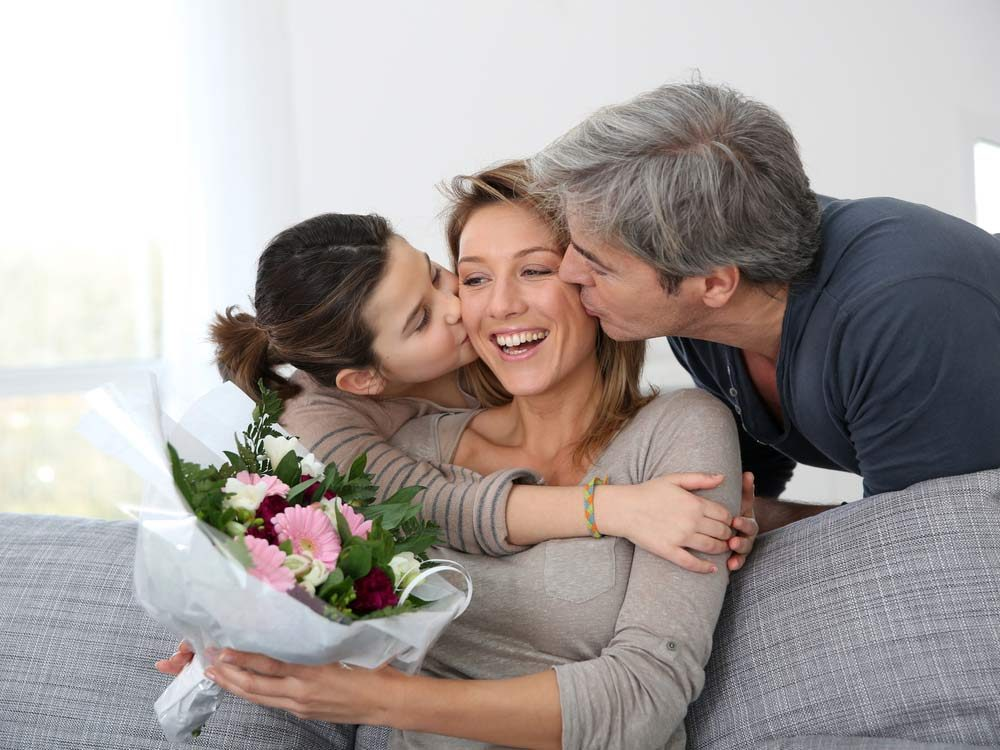 Family of three celebrating Mother's Day