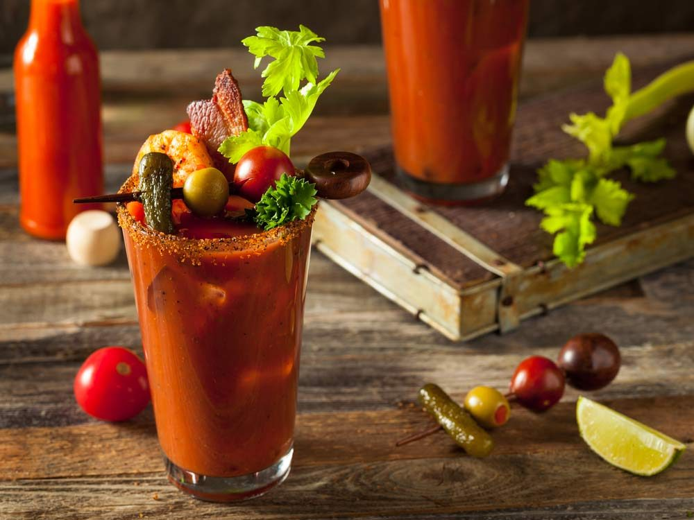 Homemade Bloody Mary cocktail with bacon