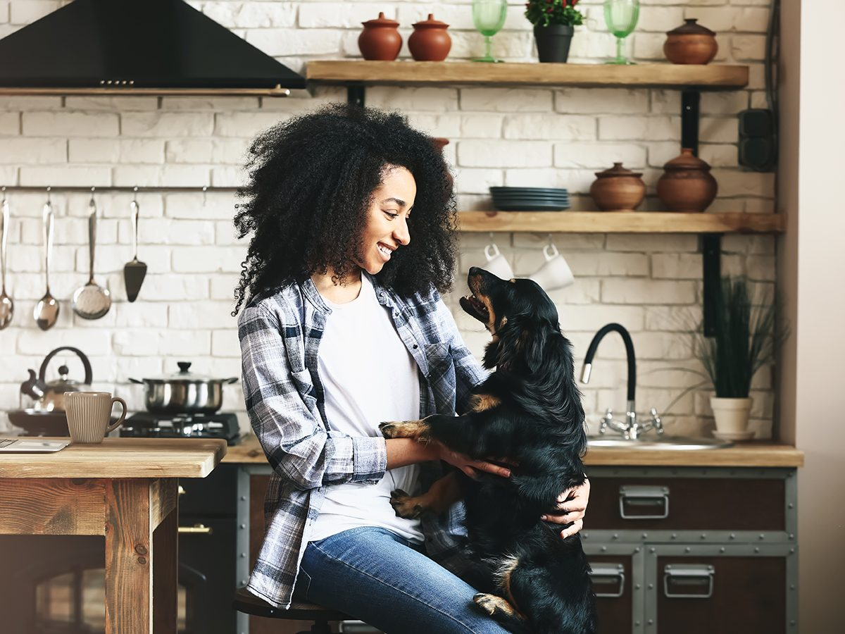 Homemade dog food recipes - woman and dog