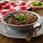 Black bean soup garnished with spring onions