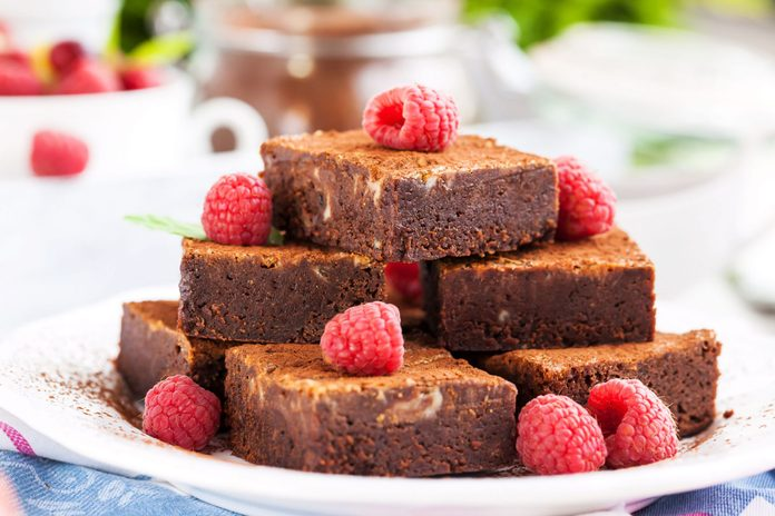 Chocolate brownies garnished with raspberries