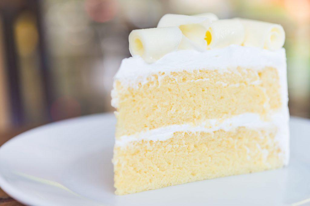 Slice of white chocolate cake
