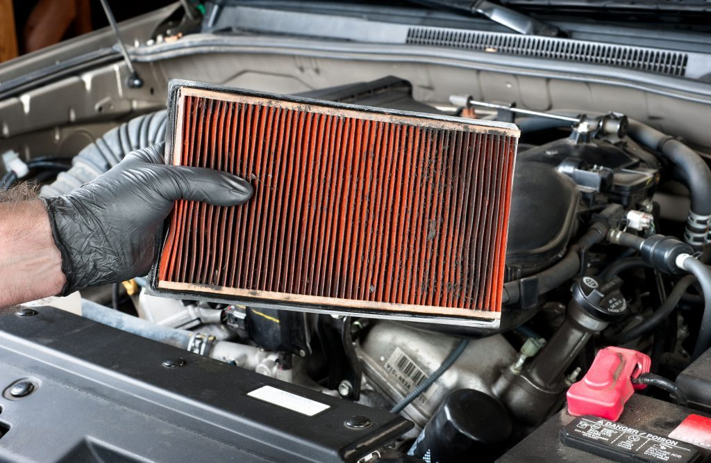Man checking car air filter
