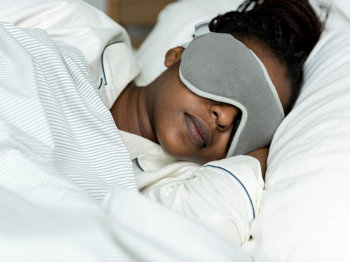 A woman sleeping with a sleeping mask