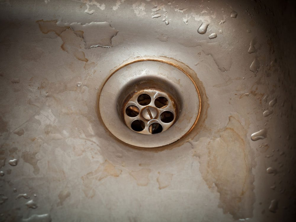 Rusty drain hole of sink
