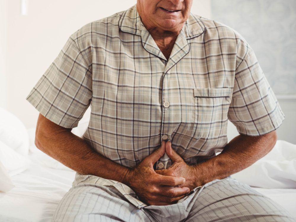 Senior man with abdominal pain