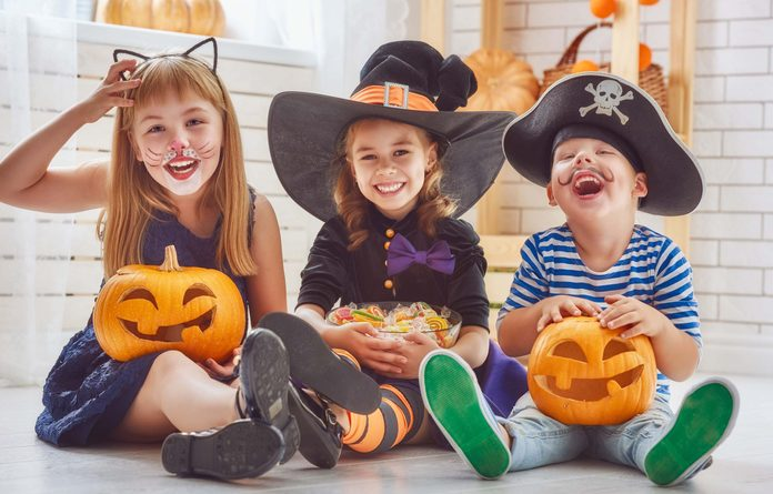 Kids eating Halloween candy and other treats