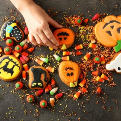 Female hand picking of Halloween cookie