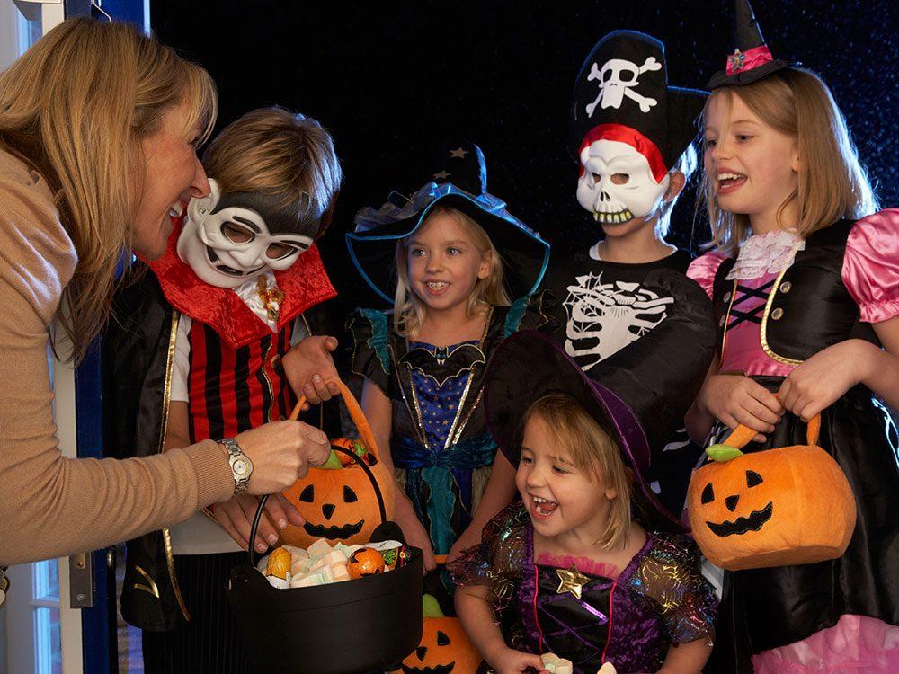 Canadian children trick-or-treat on Halloween
