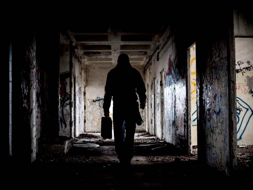Ominous person in run-down building