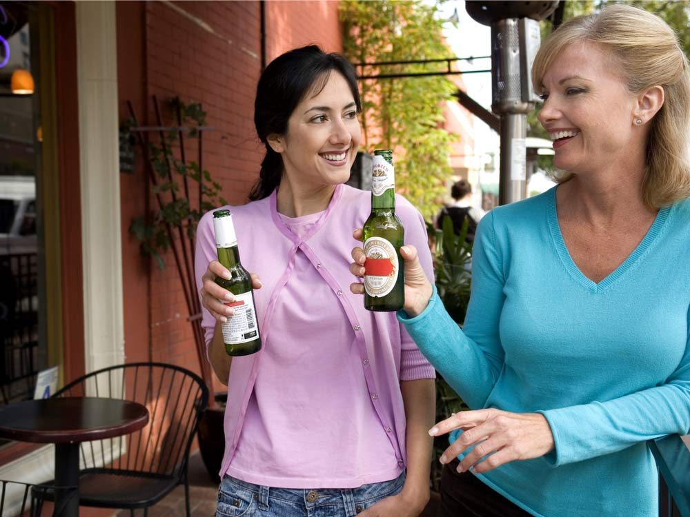 Two women enjoying beers in San Diego, California