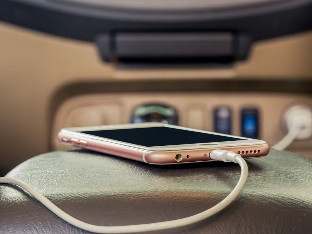 Smartphone being charged in car