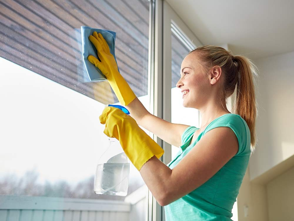 Woman cleaning windows