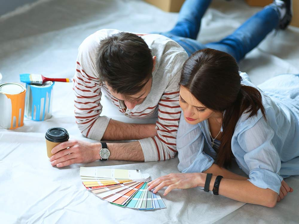Couple looking over paint options