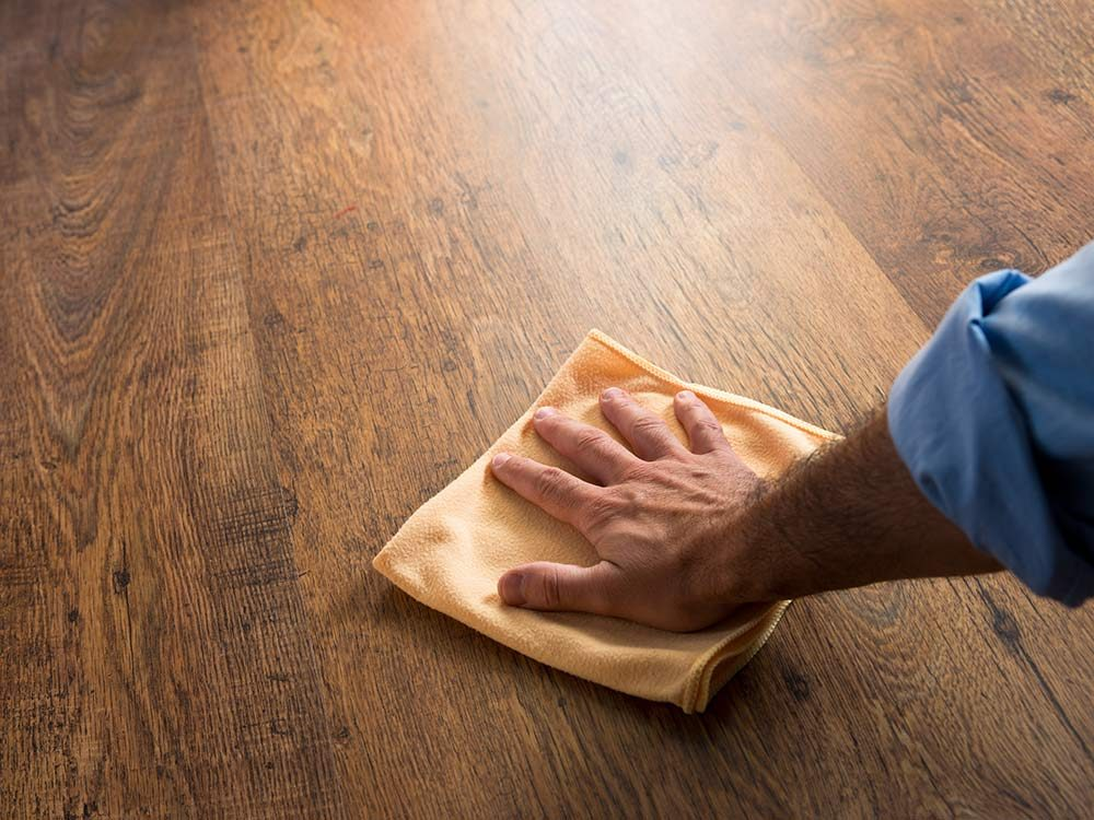 Man waxing floor